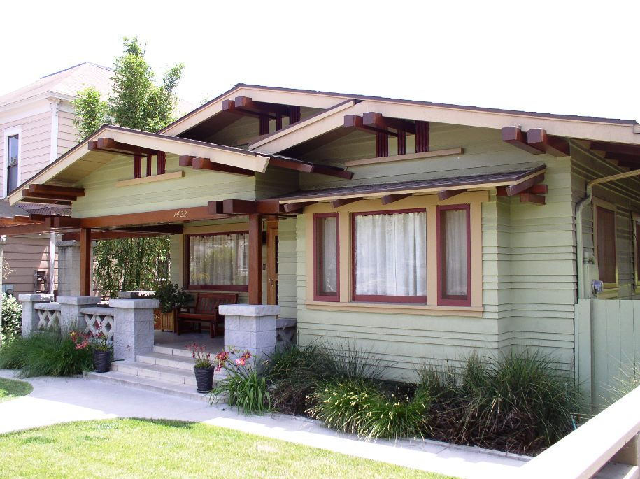 Craftsman bungalow architectural styles of america and for Low pitch roof house plans