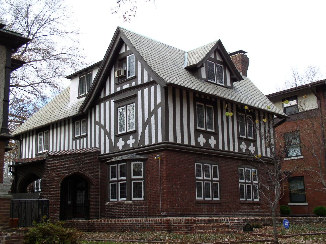 Tudor Revival on Modern House With Curved Roof Design